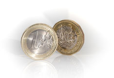 Euro coin with new pound coin. The new english pound coin with the european monetary unit, the euro Royalty Free Stock Images