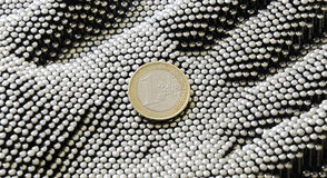 Euro coin on pin hand Stock Photos