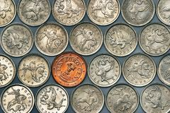 Euro coin among russian coins Royalty Free Stock Photo