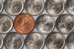 Euro coin among russian coins Stock Photo