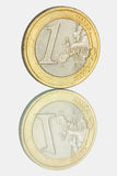 Euro coin and it's reflection. There is a reflected euro coin in the photo Royalty Free Stock Photo