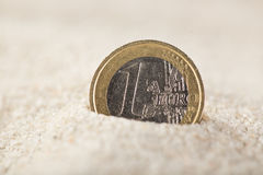 Euro coin in the sand Royalty Free Stock Image