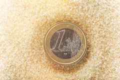 Euro coin in the sand Stock Photos
