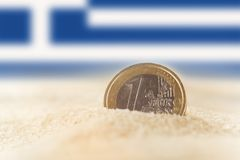 Euro coin in the sand Stock Image
