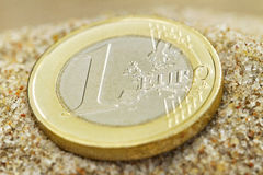 Euro coin on sand. Stock Images