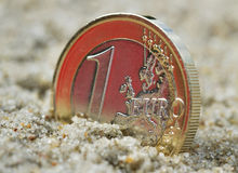 Euro coin on sand. Stock Photography
