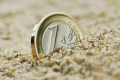 Euro coin on sand. Stock Photo