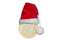 Euro coin with santa claus hat Royalty Free Stock Photography