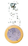 Euro coin sinking in water Stock Image