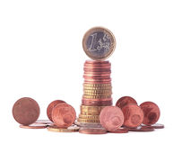 1 Euro coin standing on top of stack of euro coins surrounded by smaller value standing coins Stock Images