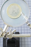 Euro coin under magnifier Stock Photography