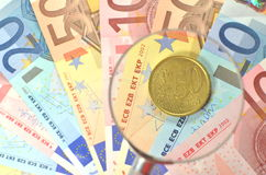 Euro coin under magnifying glass Stock Images