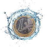 Euro coin with water splash. Euro coin with water splash isolated on white background Stock Images