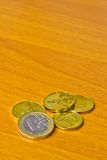 Euro coin on wood table Stock Photo