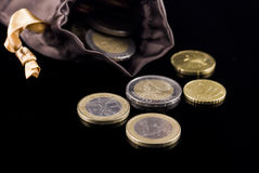 Euro coins. With purse isolated on black background Royalty Free Stock Images