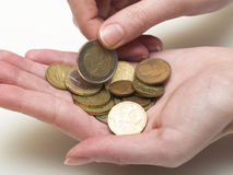 Euro coins. Handful of euro coins in women's hands royalty free stock photo