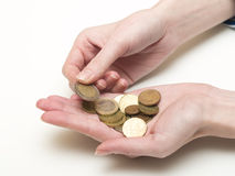 Euro coins. Handful of euro coins in women's hands stock photography
