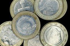 Euro coins on black background. 1 Euro coins on black background royalty free stock photo