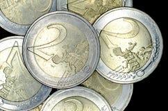 Euro coins on black background. 2 Euro coins on black background royalty free stock photos