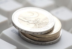 Euro coins. Over computer keyboard stock photo