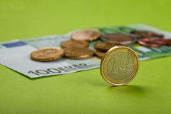 Euro coins. One hundred Euro bill and coins Stock Images