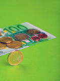 Euro coins. One hundred Euro bill and coins Royalty Free Stock Image