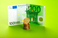 Euro with coins. One hundred Euro bill and coins Royalty Free Stock Photography