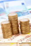Euro coins. On banknote money background stock photography