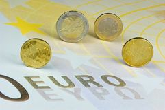 Euro coins. On an euro banknote Royalty Free Stock Photos