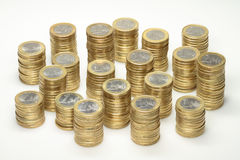 Euro coins. About 300 euro coins lying on several stacks royalty free stock images
