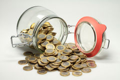 Euro coins. From a jar euro coins are distributed Stock Photos