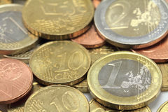 Euro coins. One euro coin on the foreground.Shallow DOF Royalty Free Stock Photo