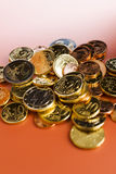 Euro coins. Stack of euro coins on the red table stock photography