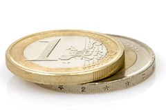 Euro Coins. Close-up of one and two euros coins isolated over a white background Royalty Free Stock Photos
