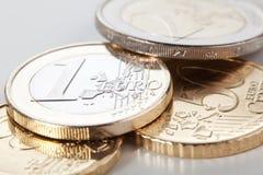 Euro Coins. Various euro coins close-up over a light background stock photos
