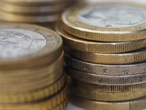 Euro coins background. Background with a close view on a one euro coins stock photo