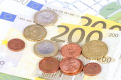 Euro Coins and Banknotes with Touristic Travel Map. Euro coins and banknotes with city map background in touristic travel concept Stock Photography