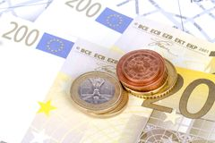 Euro Coins and Banknotes with Touristic Travel Map. Euro coins and banknotes with city map background in touristic travel and finance concept Stock Image