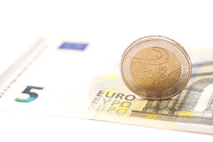 2 euro coins on banknotes Stock Images