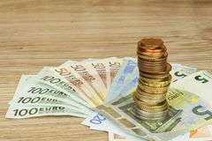 Euro coins and banknotes on the table. Detailed view of the legal tender of the European Union, EU. Stock Photo