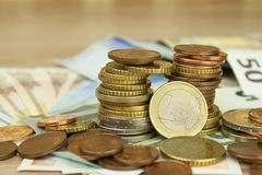 Euro coins and banknotes on the table. Detailed view of the legal tender of the European Union, EU. Stock Images
