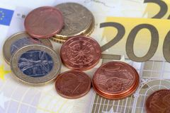 Euro Coins and Banknotes with Touristic Travel Map. Euro coins and banknotes with city map background in touristic travel concept Stock Photo