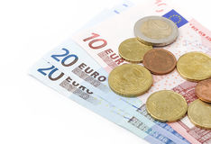 Euro coins and banknotes Stock Photos