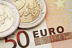 Euro coins and bills Stock Photos