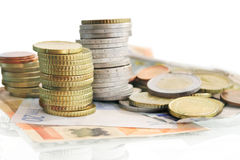 Euro coins with bills Stock Photography