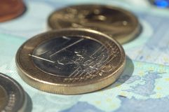 Euro coins and bills of different value. Shallow depth of field royalty free stock photography