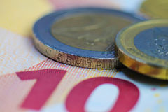 Euro coins and bills, macro photography. Royalty Free Stock Photography