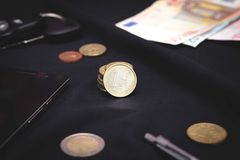 Euro coins on a black background Stock Photo