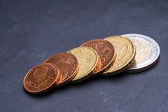 Euro coins on a black stone plate. 1 cent,2 cent,10 cent,5 cent,20 cent and 2 euro coins stock photos