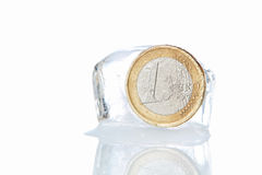 Euro coins in a block of ice. Inflation. Royalty Free Stock Photos